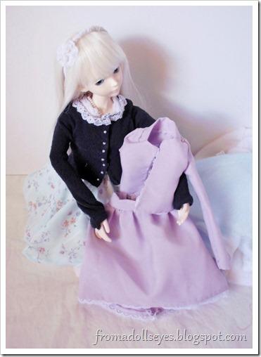 Sorting through pretty doll clothes.