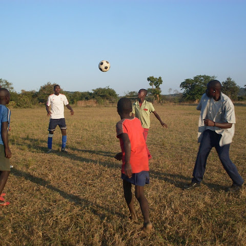Football is very popular in Zambia and all across Africa. These people are fortunate to be useing a 'proper' football.