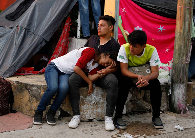 Migrants rest Thursday in Pijijiapan, Mexico, where the caravan has met with an outpouring of help from residents, 26 October 2018. Photo: Rebecca Blackwell / AP