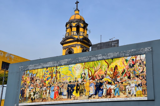 Diego Rivera mural. From Go Eat Give combines travel, food, and volunteering