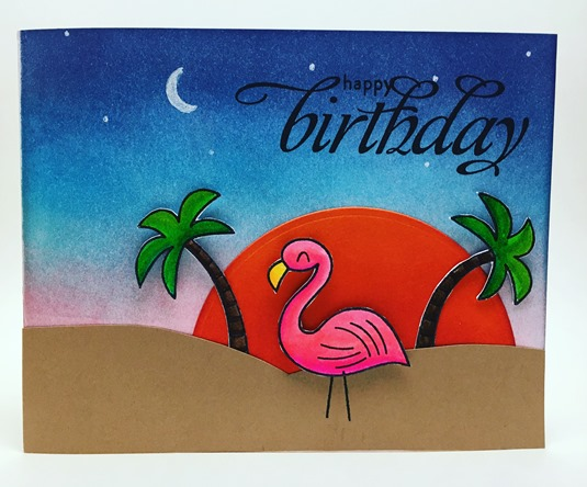 Happy birthday greeting card featuring beach sunset with flamingo