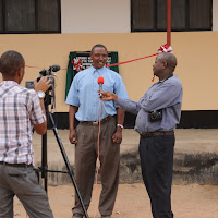 A Tanzanian TV station interviews community members about our health center.