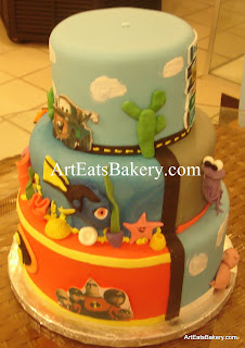 Disney - Pixar kid's birthday cake with Cars - towmator, finding Nemo - dori and the Incredibles