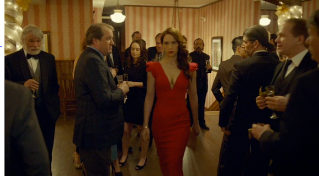 Wynonna in a red dress