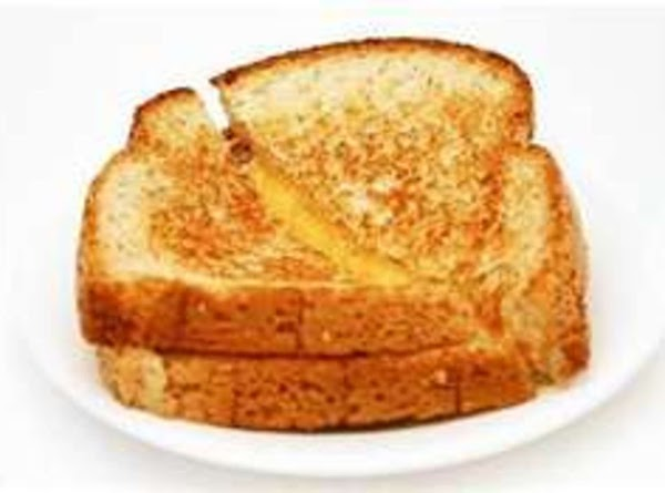 GRILLED CHEESE SANDWICHES: Grandma buttered whole wheat bread and made a grilled cheese sandwich...