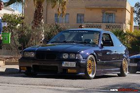 Purple E36 Coupe on Gold wheels