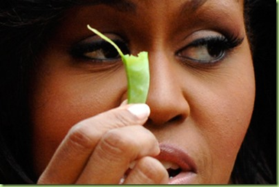 u_s_first_lady_michelle_obama_holds_a_bean_harvested_from_vegetables_grown_in_her_garden_at_the_white_house_in_washington_june_16_2009