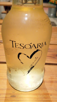 Sparkling muscat in a growler bottled for you from the tap at the Tesoaria Tasting Room on North Williams