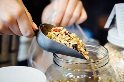 pouring_granola_into_jar.jpg.662x0_q70_crop-scale