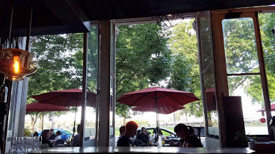 LeChon's large patio/window doors that open out to their sidewalk tables and the waterfront of Portland