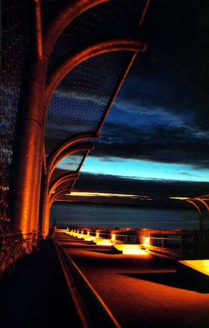 The Taylor Dock Boardwalk lights up at night.Credit: Danny Lauve
