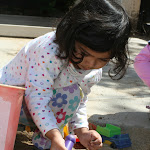 LePort Montessori Preschool Toddler Program Irvine Orchard Hills girl playing in the sand box