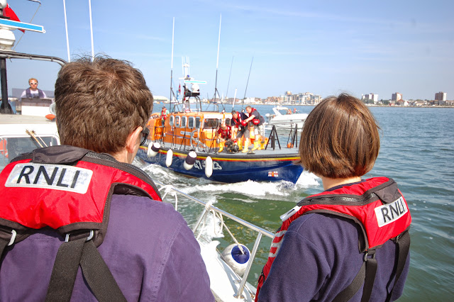 Trainee Suzie Jupp (right) and Crew Member Chris Speers waiting onboard the 'casualty' vessel to receive the salvage pump from the Tyne class lifeboat, with JK at the helm  Photo: RNLI Poole/Dave Riley