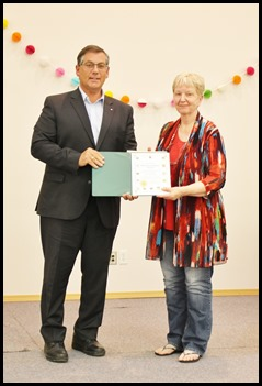 Presentation Ceremony One Presenter  was Battle River-Crowfoot MP Kevin Sorenson with Pastor Darleene
