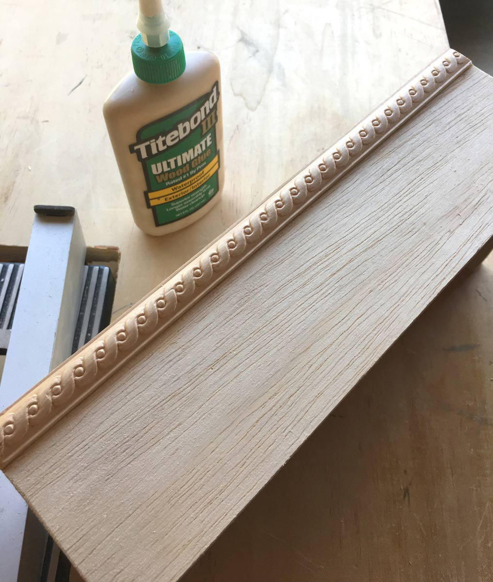 Adding trim to cover unfinished edge of plywood