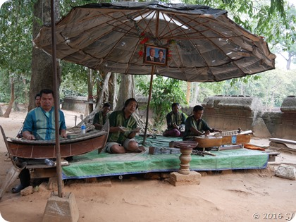 Men singing and playing instruments at Banteay Srei