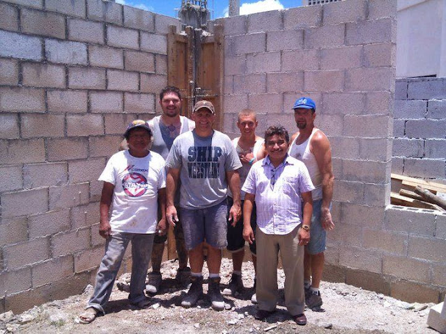 The team photo in front of the finished job. (From left to right) Isaias, Joel, Scott, Seth, Gabriel Góngora (Bible School Director), and Bruce