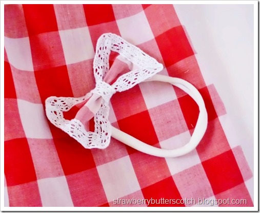 Lacey gingham print bow headband for baby.