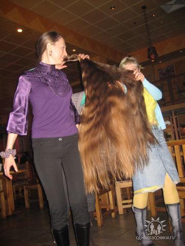girls play with very long hair braid