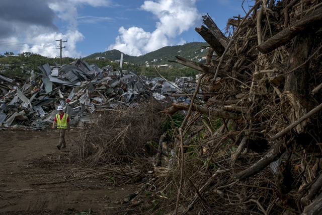 Piles of debris litter St. Thomas in the U.S. Virgin Islands. Disposing of tons of roofing materials and vegetal debris is a significant challenge for the islands. Environmentalists oppose an Army Corps of Engineers plan to burn debris. Photo: Bonnie Jo Mount / The Washington Post