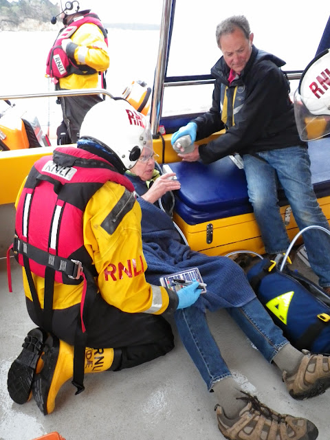 Crew Member Joe Manning checking a casualty's symptons onboard Dolphin III during a training exercise - 22 April 2014 Photo: RNLI Poole/Anne Millman
