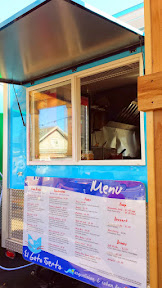 Portland Mercado has 8 carts in the food cart pod, where each food cart specializes in different Latin cuisine. The blue El Gato Tuerto cart brings Cuban/Argentinian Food to the cart pod.