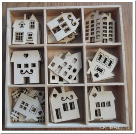 wooden house embellishments in tray