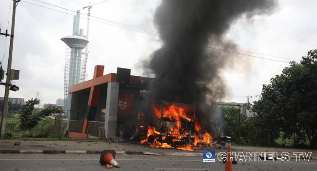 A Youth Corps Member Of Channels TV Shot As Shiite Protesters Clash With Police In Abuja