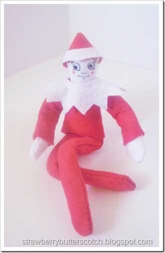 A diy elf on the shelf all dressed in felt.