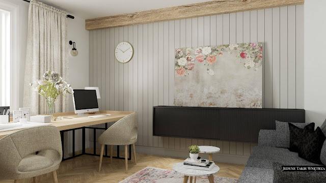 Przytulny, domowy gabinet w skandynawskim stylu, w którym znajduje się drewniane biurko na loftowych nóżkach.