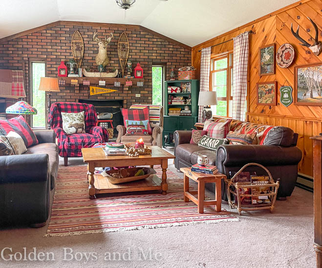 Family room at mountain cabin with gallery wall and paint by numbers - www.goldenboysandme.com
