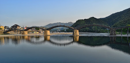 Photo: Reflections of Kintai  The Kintai Bridge is a very old bridge in Yamaguchi Prefecture, in the city of Iwakuni, Japan. When it was originally constructed, the bridge contained no metal parts - it was made entirely out of wood, laid on top of the stone pillars. However, due to many floods over the centuries, it has been washed away and rebuilt. It's a very beautiful area, and well worth the trip - particularly if you can go during Cherry Blossom season!  #japan