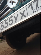 Photo: bracket for front American license plate underneath the Russian plate