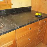 Soapstone countertop, cherry cabinets