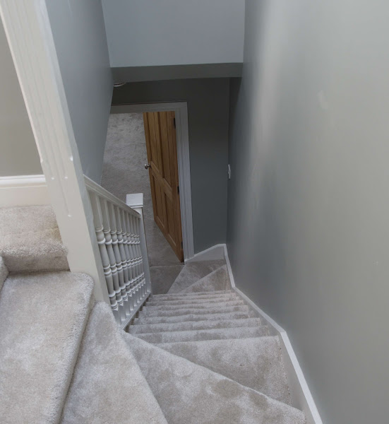 a carpeted staircase leading to a loft