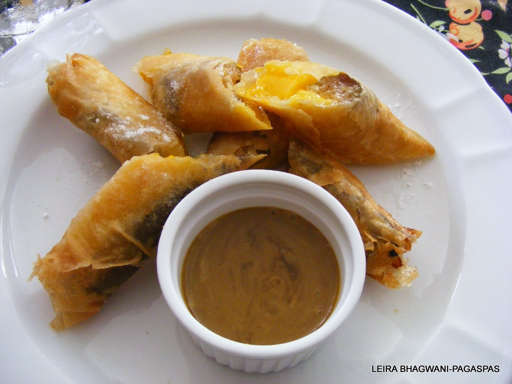 Turon Manga in Suman served with Palm Sugar and Coco Cream Sauce. It