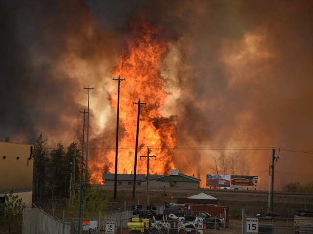 The out-of-control fire swept into Fort McMurray, Alta., on 3 May 2016, forcing evacuation of the city. The fire burned neighbourhoods and moved into the downtown core. Photo: Terry Reith / CBC
