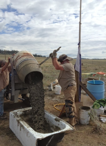 Pouring mixed cement into a tub, September 2013