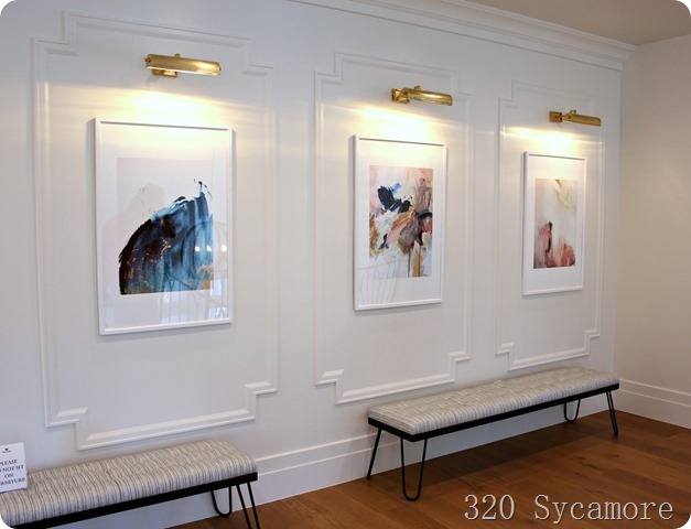 moldings and lights to showcase wall art