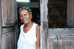 "My favourite photo from Cuba. This woman was standing in her doorway. I said ""Hola!"" as I walked by and continued on. I had to go back and walked up her steps to take her portrait. I then told her ""Usted es muy Cubano"" (""You are very Cuban"") That's about the best compliment I could pay her in my limited Spanish."