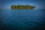 Beautiful island like these one contain only a few Kuna houses and quiet sandy beaches.