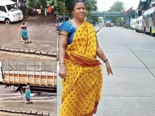 women stand 7 hours near manhole to indicate road