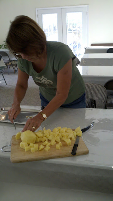 Sandy prepares the potatoes