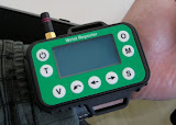 The Wrist Reporter shown in relation to a forearm, where it is typically mounted.