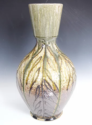 wood-fired vase with slipping trail details