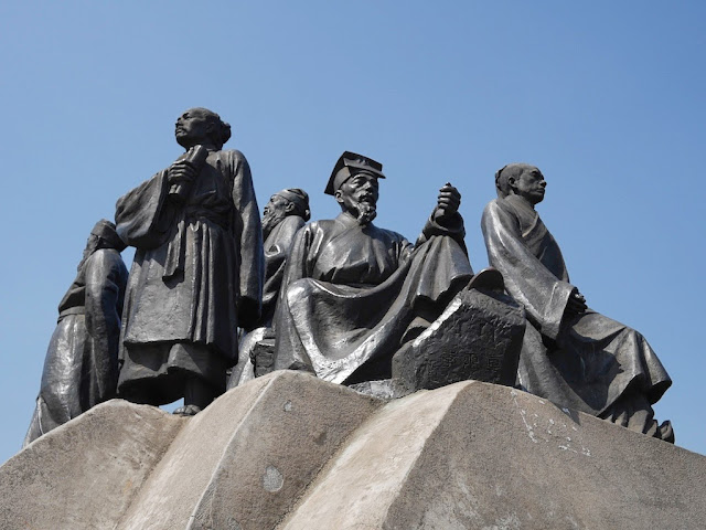 statues of scholars on a large rock in Shigu Park, Hengyang