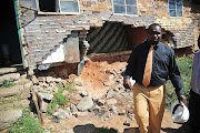 FILE PICTURE: Former MMC for Housing in the City of Johannesburg Dan Bovu looking at a room falling apart at Diepkloof hostel in Soweto.