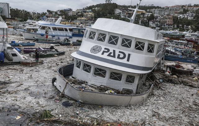 Boats pushed ashore by Typhoon Mangkhut's strong waves in Sai Kung, 16 September 2018. Photo: May Tse / SCMP