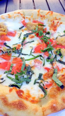 Altabira City Tavern's Happy Hour, Roma Tomatoes, Roasted Garlic, Fresh Mozzarella and Basil Pizza