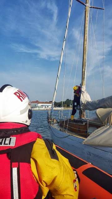 Poole ILB coming alongside the now floating yacht after towing it with the ALB off Hook Sands - 8 August 2013 Photo: RNLI/Poole